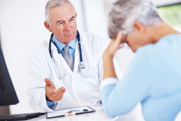 Doctor discussing reports with unhappy patient